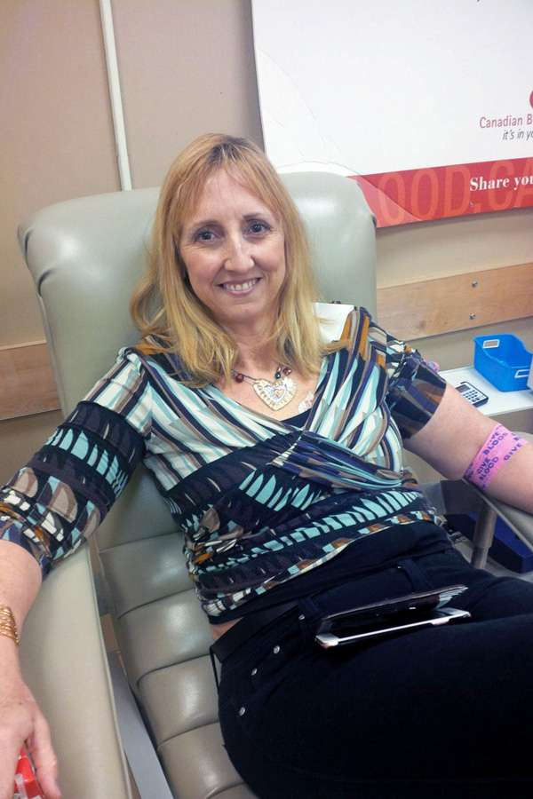 Cathy from childbirth relaxes after her donation.