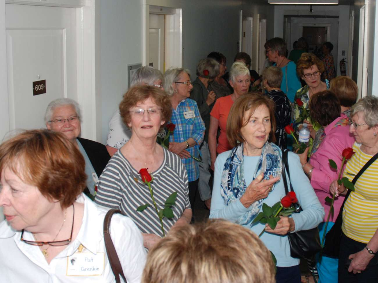 Tour participants in the Kaufman building, their former residence as nursing students