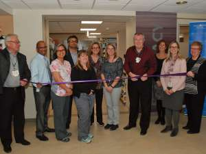 Pharmacy staff and GRH leaders cut the ribbon to officially open the renovated Health Care Centre Pharmacy.