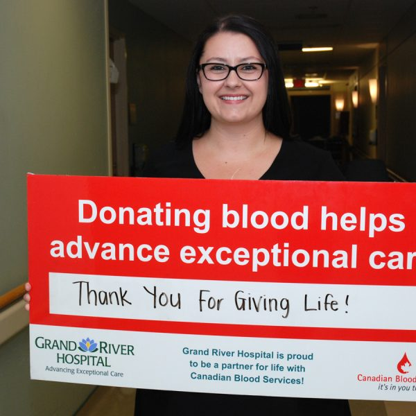 Carla Sluser With The Canadian Blood Services Sign