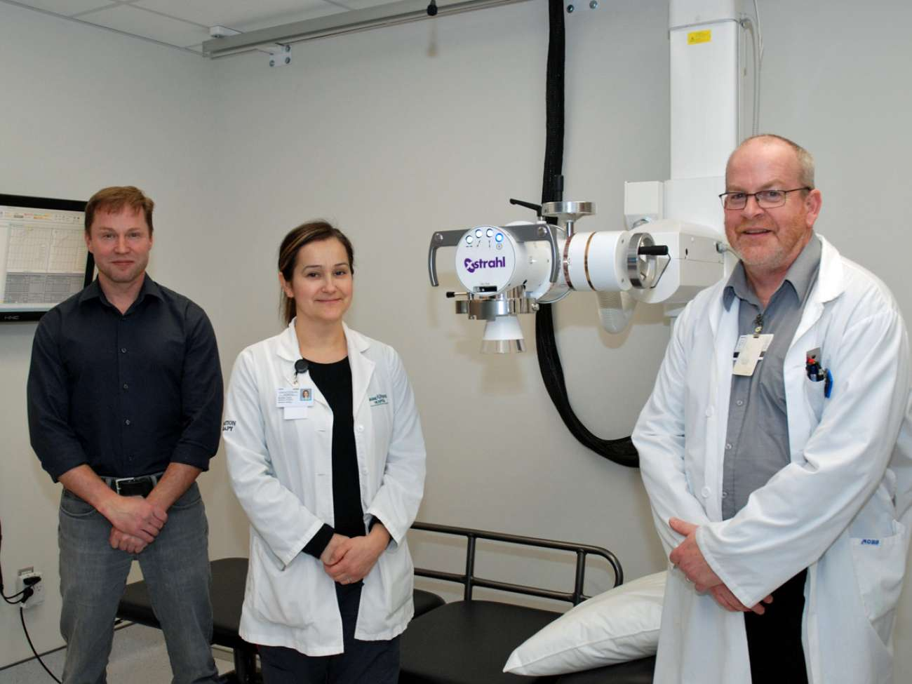 Medical physicist Andre Fleck as well as radiation therapists Andrea Tonin and Bruce Fleming pause inside of the new orthovoltage suite at GRH's regional cancer centre.