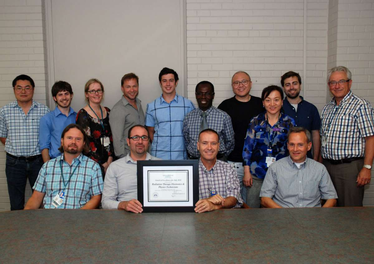 An award photo for GRH's electronics and physics technicians
