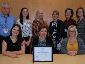 Members of the clinical trials receive their award of excellence from hospital leaders