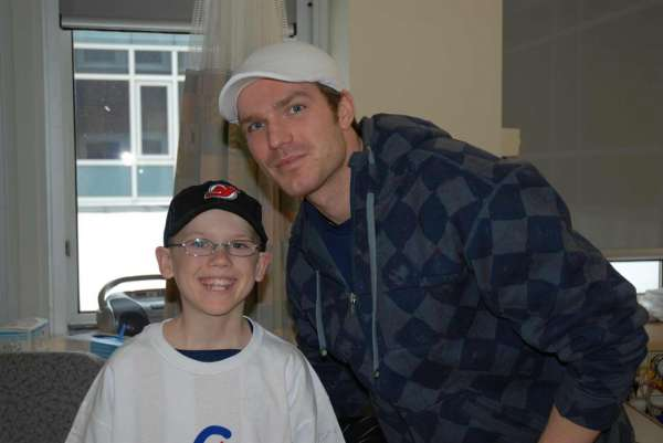 A photo of David Clarkson with one of our patients.