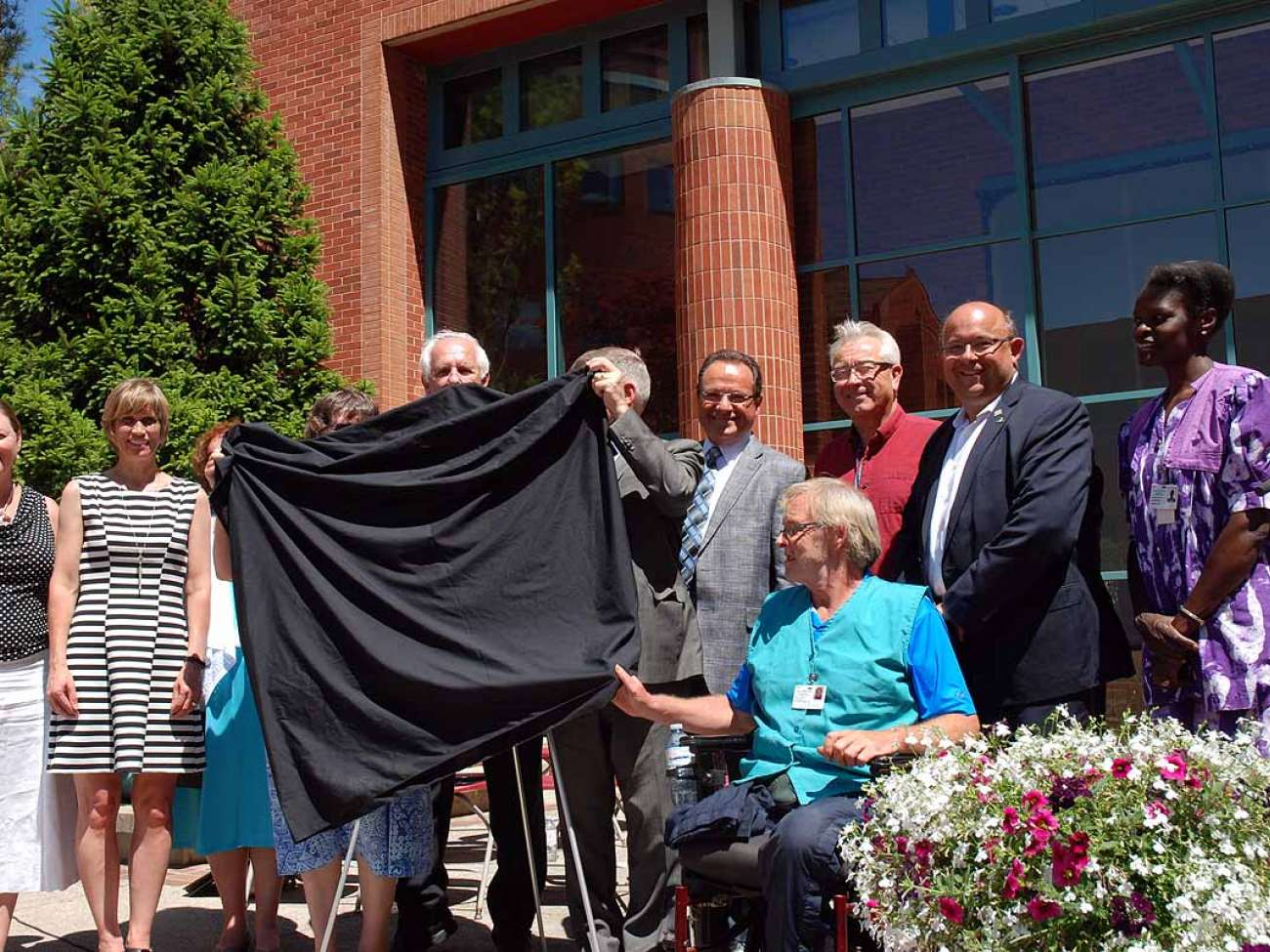Unveiling a plaque to commemorate the century of care