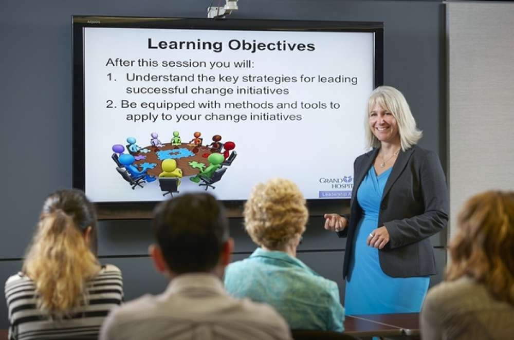 A photo of employees at an education session