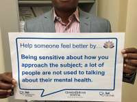 Dr Okonkwo's sign reads: help someone feel better by being sensitive about how you approach the subject; a lot of people are not used to talking about their mental health.thumbnail image.