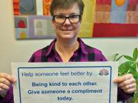 Jaylene's sign reads: help someone feel better by being kind to each other. Give someone a compliment today.thumbnail image.