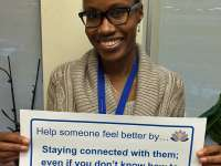 Shani's sign reads: help someone feel better by staying connected with them; even if you don't know how to help or what to say.thumbnail image.