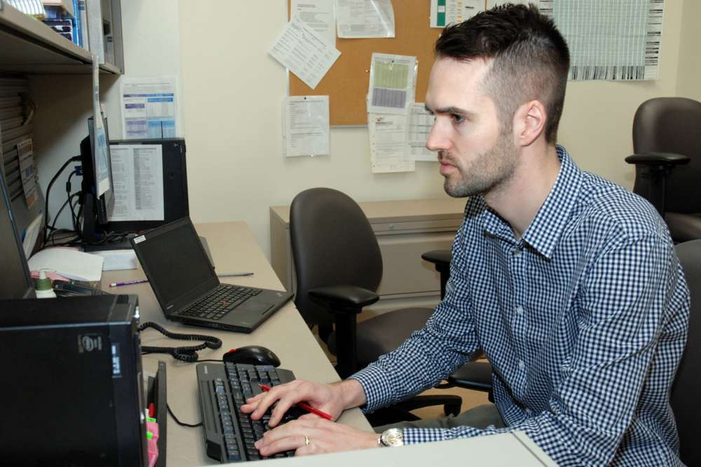 Jack Bodkin reviews orders in GRH's inpatient pharmacy