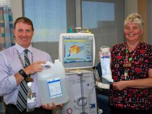 Peter Varga and Nancy Evans show the renal bi-carbonate containers and new powder plastic bags.