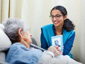Shwetha Suresh volunteers with a patient at GRH's KW Campus