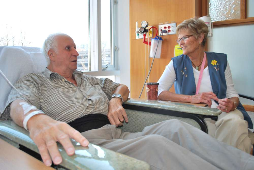 A patient of a volunteer with a patient in the chemotherapy suite