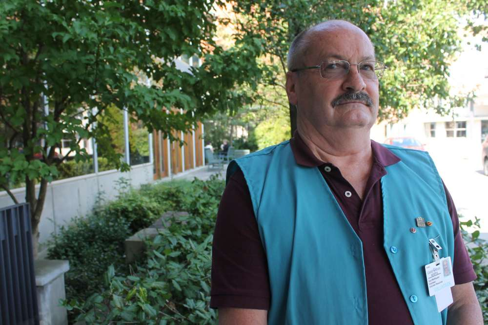 Guy Wellhauser stands in front of GRH's regional cancer centre