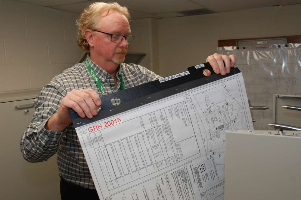 Greg Donnell reviews facilities plans in the hospital's maintenance department