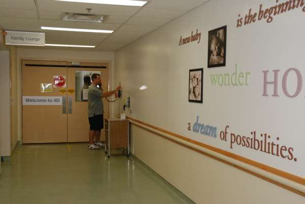A photo of a family member calling the childbirth unit prior to entering