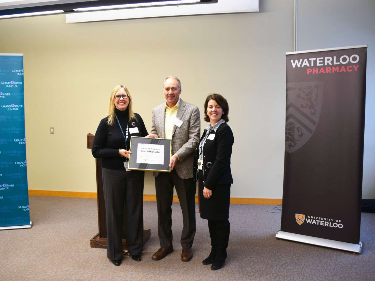 GRH's Jane Martin and Judy Linton (left, right) accept a plaque from Dr. David Edwards (University of Waterloo, middle).