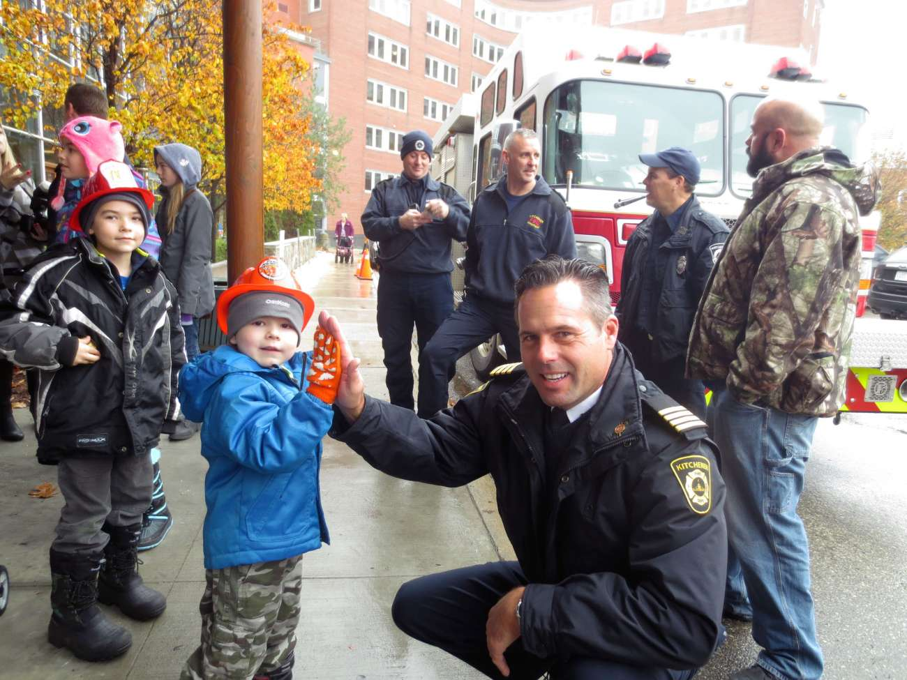 Evan gets a high-five from Deputy Fire Chief Bob Gilmore