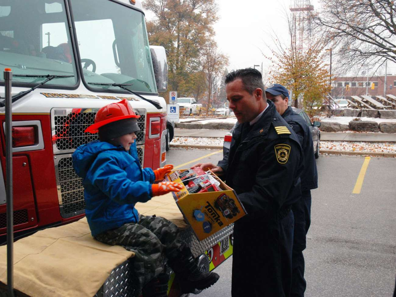 Kitchener's Deputy Fire Chief Bob Gilmore gives Evan his very own fire truck