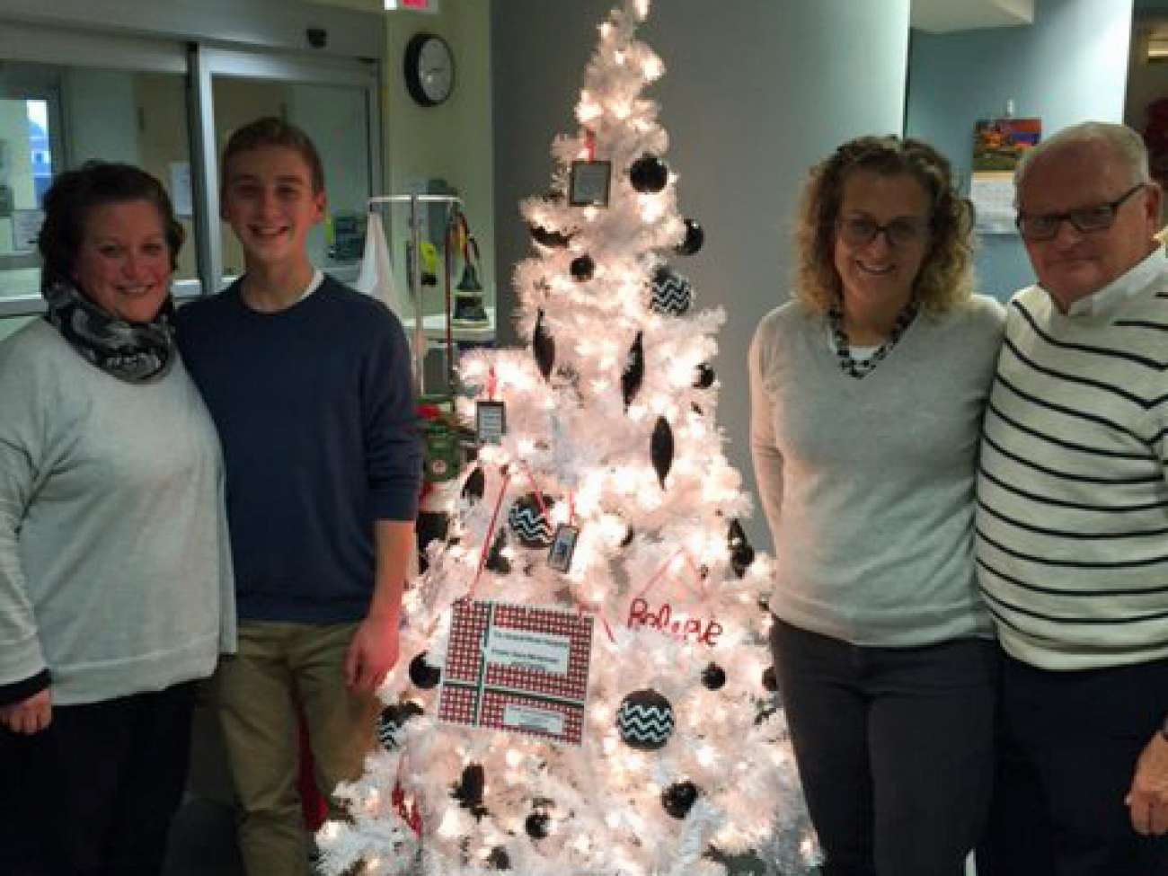 The people who made the tree happen include (left to right) Blake's mom Heather McLennan, Blake, his aunt Sara McLennan and his grandfather John McLennan